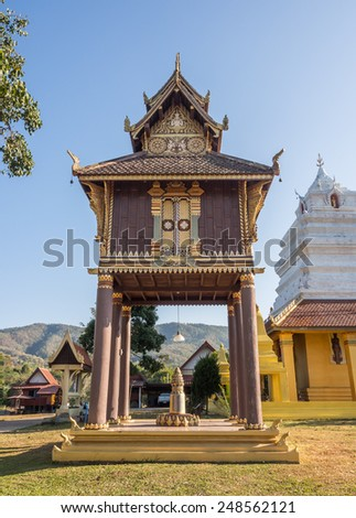 """Hor Trai"" (place for keeping Buddhist texts) at ""Wat Sri Pho Chai Sang Pha"" temple in Loei province, Thailand - stock photo"