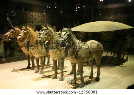4 horses leading an army of terracotta warriors in Xuzhou, China - stock photo