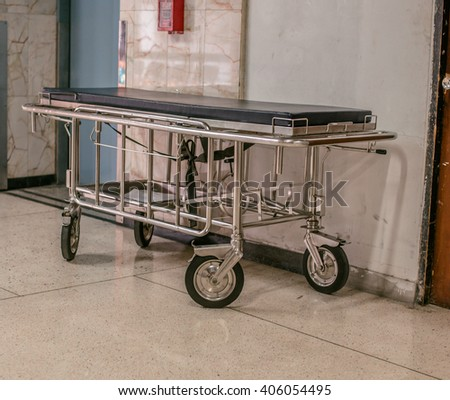hospital bed in hospital, in front of lift, Empty Bed On Hospital Ward - stock photo