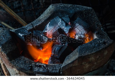 hot charcoal in the fire - stock photo