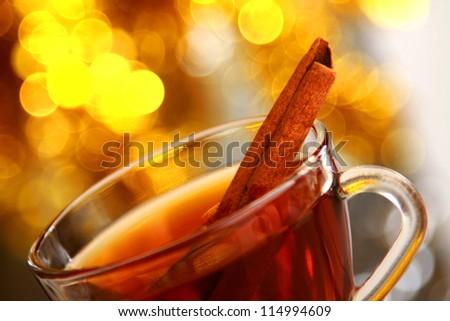 Hot christmas drink with cinnamon sticks - stock photo