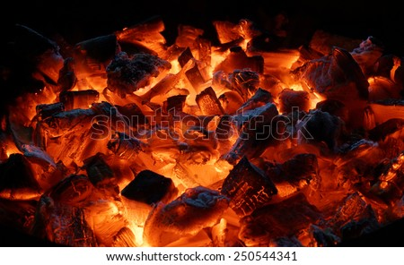 Hot red charcoals in bonefire. Night. Dahab. Sinai. Egypt.                           - stock photo