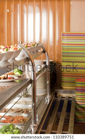 Hot trays with cooked food close-up in dining room - stock photo