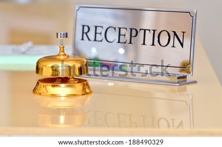 hotel bell on the table - stock photo