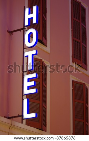 hotel sign shot at sunset - stock photo