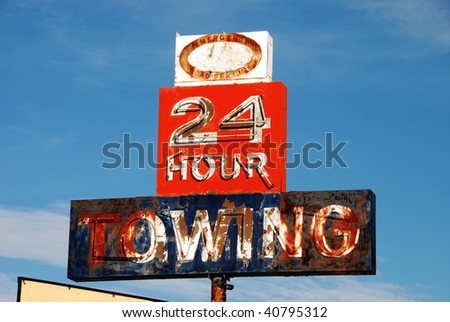24 Hour Towing Sign outside of Ron's Towing at Rice Hill Oregon - stock photo