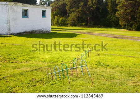 house on a green field - stock photo