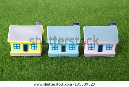 house on grass background - stock photo