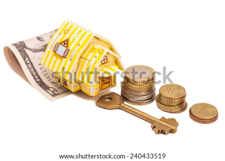 House with money and key - stock photo
