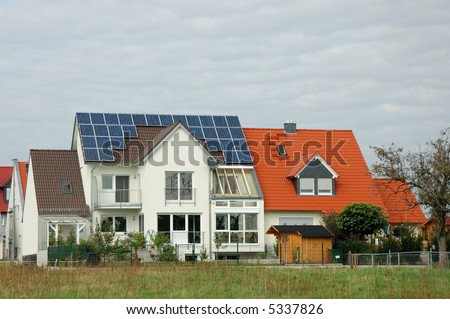 House with solar panels on the roof in germany - stock photo
