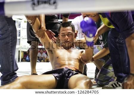 "HUA HIN THAILAND- JANUARY 25 : Unidentified players in Muaythai "" Muay Thai Kai Chon"" on January 25 , 2013 at Khoa Kittisukato temple Hua Hin Thailand - stock photo"