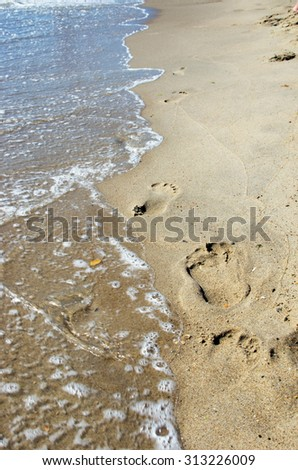human prints on the beach. - stock photo