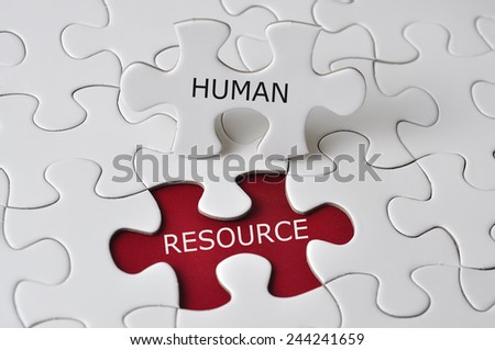"""""""HUMAN RESOURCE"""" On Missing Piece Puzzle, selective focus - stock photo"""