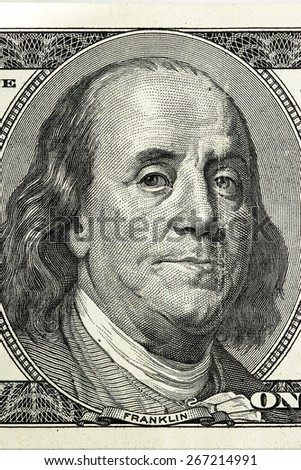 Hundred dollar bill close-up fragment, Benjamin Franklin.