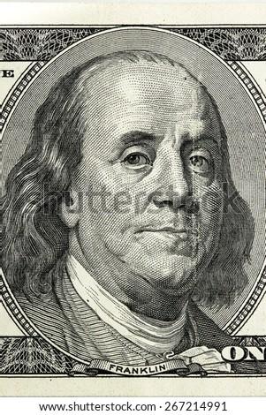 Hundred dollar bill close-up fragment, Benjamin Franklin. - stock photo