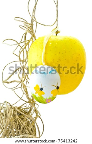 ,hung egg and apple to a thread, - stock photo