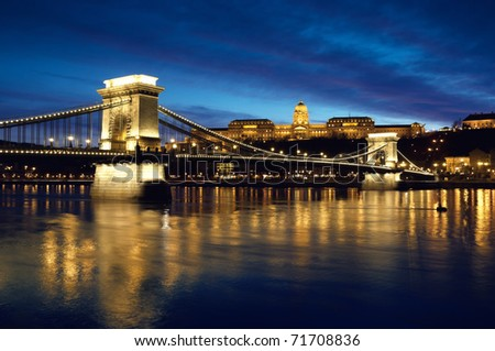 Hungarian landmarks, Chain Bridge, Royal Palace and Danube river in Budapest at night. - stock photo