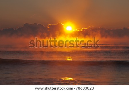 Huntington Beach State Park Sunrise SC With Ocean Fog Horizontal - stock photo
