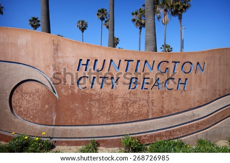 Huntington City Beach sign with palm trees                               - stock photo