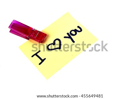 """I love you"" message written on a yellow paper note with a clothespins holding isolated on white background  - stock photo"