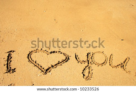 """""""I love you"""" message written on the golden sand - stock photo"""
