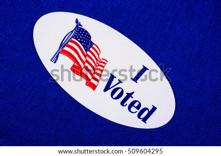 """I Voted"" Sticker on a blue or Democratic Background"