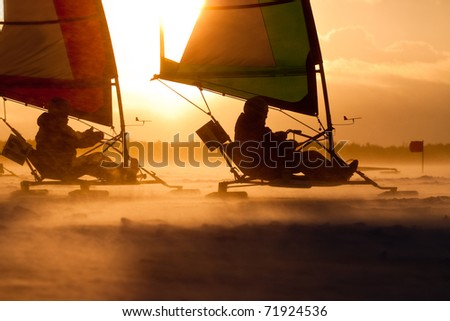 Ice-sailors are speeding up in a Race. Facing an extreme Blizzard, strong Wind - stock photo