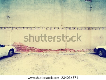 image from exteriors background texture series (alleyway building and walls) toned with a retro vintage instagram filter effect - stock photo