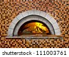 Image of a brick pizza oven with fire - stock photo