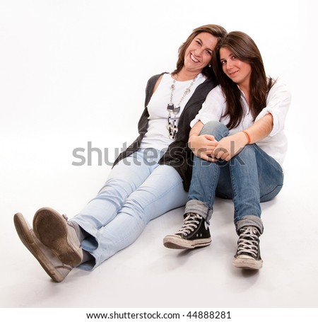 image of a mother and daughter happily together sitting on the floor