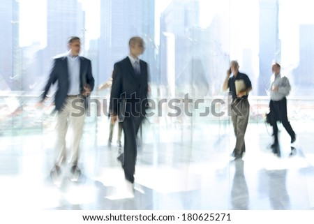 image of people in the lobby of a modern business center with a blurred background - stock photo