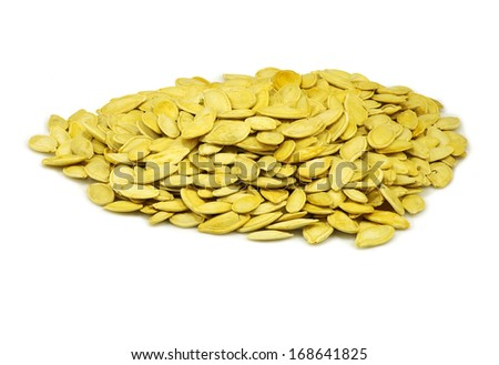 image of pumpkin seeds on a white background - stock photo