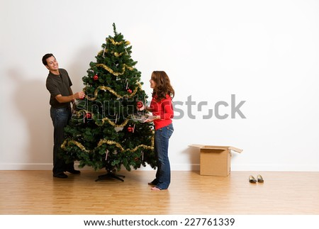13 Image Series Of A Couple Assembling An Artificial Christmas Tree - stock photo