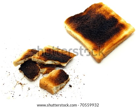 2 images of burnt toast on a white background - stock photo