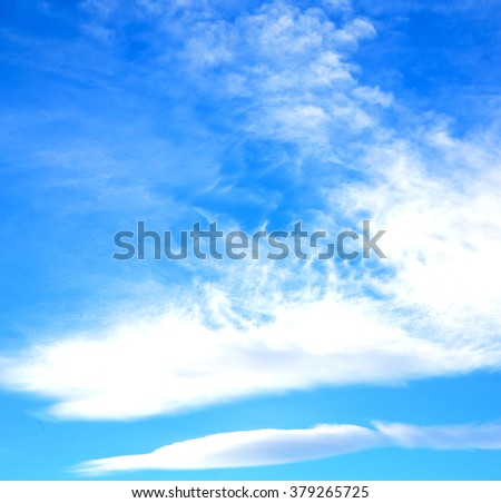 in the blue sky white soft clouds and abstract background