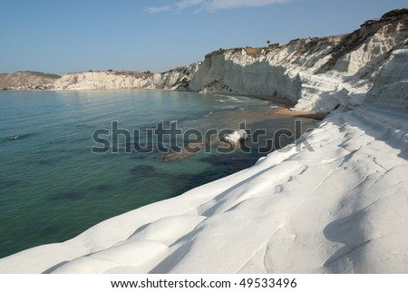 """In the province of Agrigento (Sicily) is the """"Scala dei Turchi"""" is consists of a prominent outcrop of white rock on the sea and the form that this monument natural takes is precisely of a staircase - stock photo"""