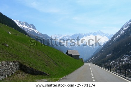 In vacation, driving in the Swiss Alps, Switzerland - stock photo