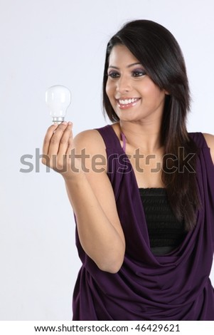 indian businesswoman with bulb - stock photo