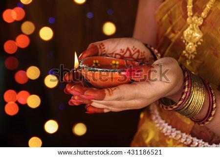 Indian girl holding Oil Lamp  - stock photo
