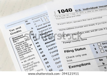 1040 Individual Income Tax Return Form for 2015 year on the white wooden desk, close up - stock photo