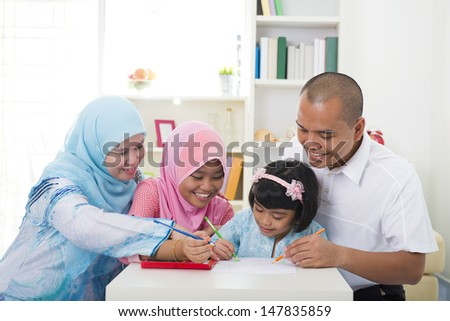 indonesian muslim family learning together with lifestyle background