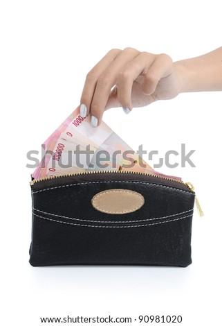 Indonesian woman's hand taking money from wallet isolated on white background