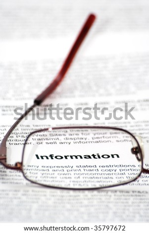 """Information"" word focused thought glasses - stock photo"