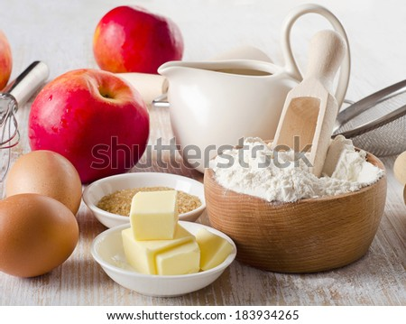 ingredients for baking apple pie on a wooden table . Selective focus - stock photo
