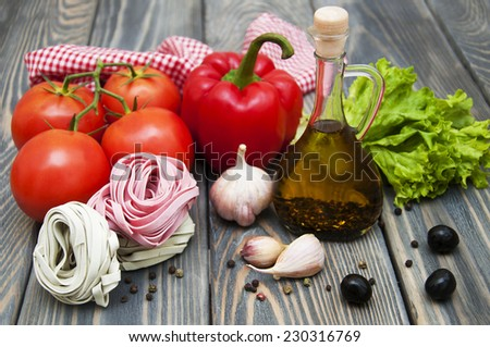 Ingredients for Italian pasta on a wooden background - stock photo
