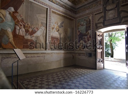 Inside the church with frescoes and statues
