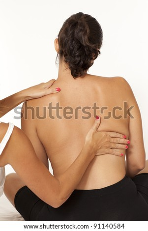Inspection of the backbone by a female doctor - stock photo