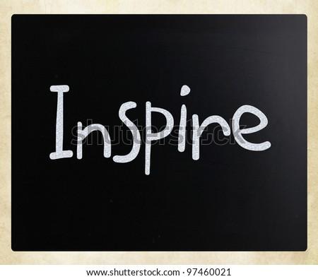 """Inspire"" handwritten with white chalk on a blackboard - stock photo"