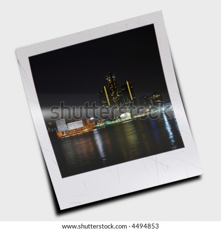 instant photo slide of night time city skyline - stock photo