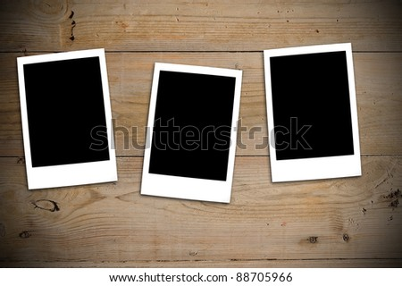 3 instant photos on wooden table